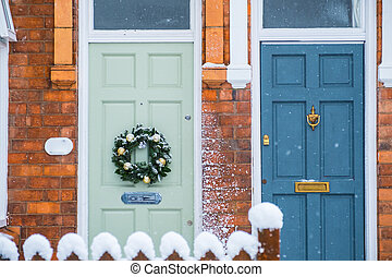 Front Doors with Christmas Wreath and Snow