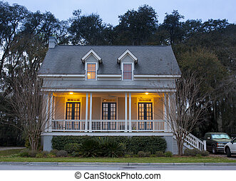 Front elevation of house at twilight