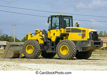 Front end loader - A front end loader sits idle during a ...