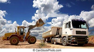 Front End Loader Filling Truck