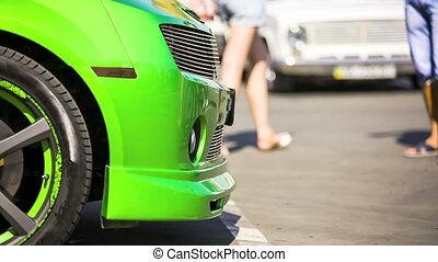 Front Hood Of Green Car At Exhibition