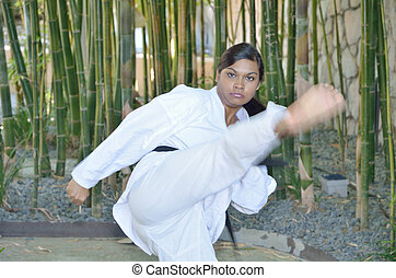 Front kick - Karate player kicking in front of her