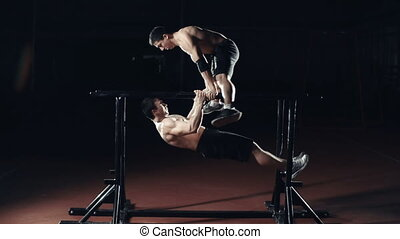 Front Lever and Planche - Side view of muscular strongmen...