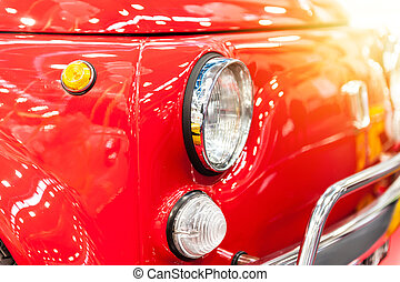 Front of a vintage red city car