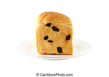 Front of bread with raisin dish on white background.