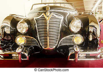 Front of Classic Limo - Chrome grill and headlights of a...