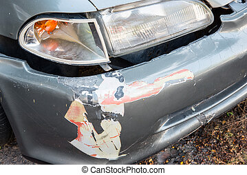 Front of gray car get damaged by accident on the road