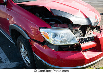 Front of red car get damaged by accident on the road