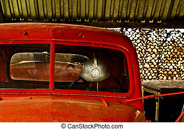 front of red oldtimer truck cabin