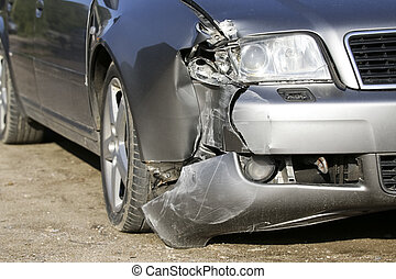 Front of silver car get damaged by crash accident on the road. Car repair or car insurance concept