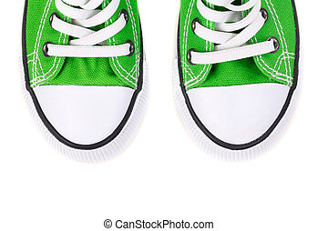 front of the green sneakers