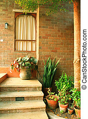Front of the italian house style with plant