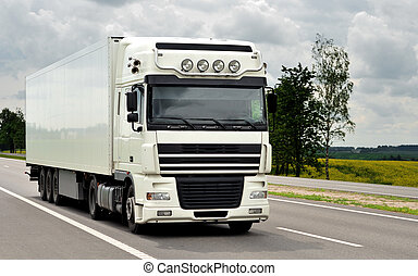 front of white truck on the highway - single white truck on...