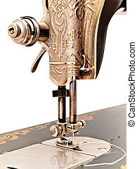 front part of old sewing machine against the white wall