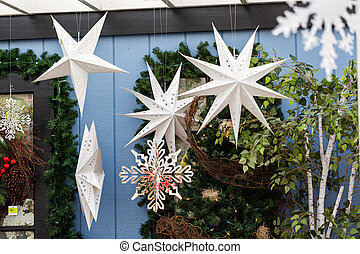 Front porch decorated with snowflakes for Christmas.