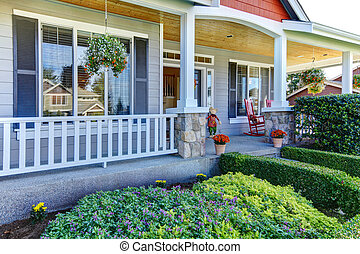 Front porch of the new beautiful grey home
