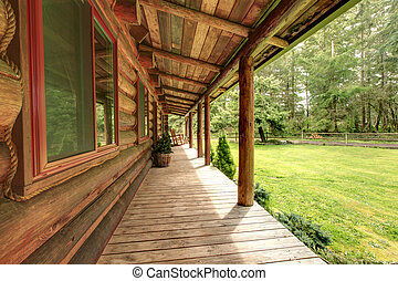 Front porch of the old rustic log cabin.