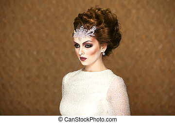 Front portrait of a beautiful bridal, with makeup and hairstyle dress wedding white dress, looking at the side.