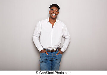 handsome young black man against gray background