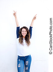 happy young woman with arms raised up