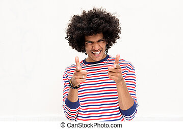 smiling young african american man with afro hair and pointing fingers isolated white background