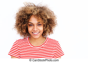smiling young african american woman with curly hair against white background