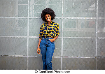 stylish young african american woman with afro smiling