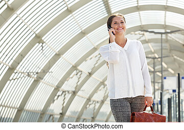 young smiling business woman talking on cellphone
