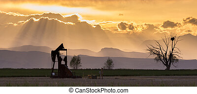 Front Range Pumpjack With Crepuscular Rays