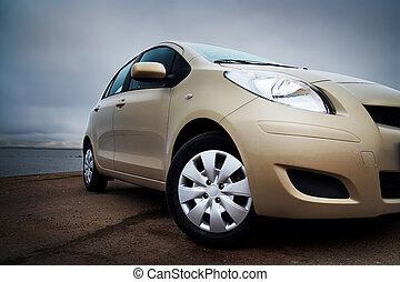 front-side, closeup, közül, egy, nyersgyapjúszínű bezs, autó