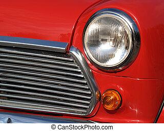 Front side of red vintage car