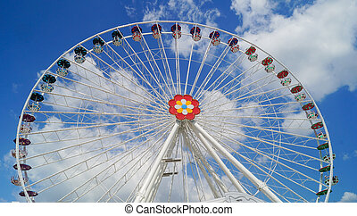 Front view A colourful ferris wheel blue sky
