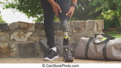 Front view man readjusting his prosthetic leg - Front view ...