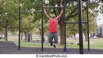 Front view man with prosthetic leg doing pull ups - Front ...