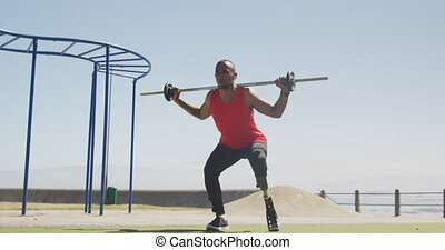 Front view man with prosthetic leg exercising - Front view ...