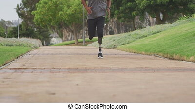 Front view man with prosthetic leg running - Front view low ...