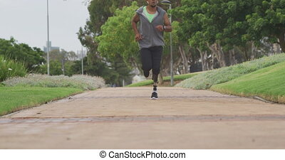 Front view man with prosthetic leg running - Front view of a...