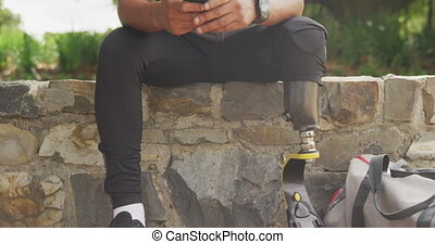 Front view man with prosthetic leg using his phone - Front ...