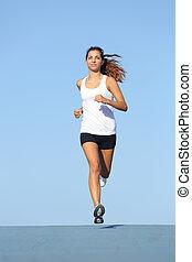 Front view of a beautiful sportswoman running towards camera...
