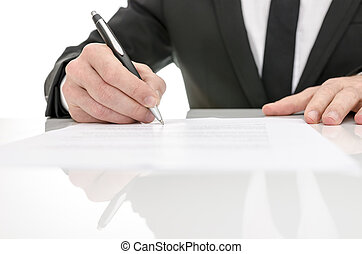 Front view of a business man signing a contract. With...