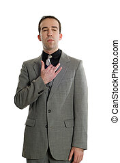 Front view of a businessman tapping his collar bone as a step in performing the Emotional Freedom Technique, isolated against a white background