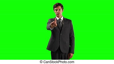 Front view of a Caucasian man touching the screen with green...
