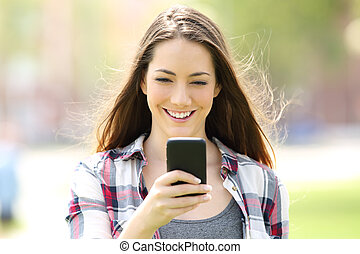 Front view of a girl using a smart phone