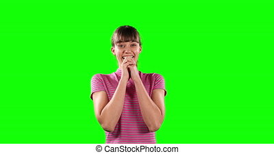 Front view of a happy Caucasian woman with green screen