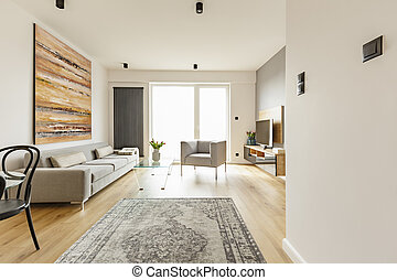 Front view of a modern living room interior with a vintage rug,