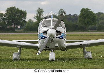 Front view of a plane on a lawn