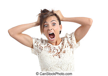 Front view of a scared woman screaming with hands on head ...