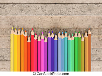 front view of a set of colored pencils on wooden background with blank space at the right (3d render)