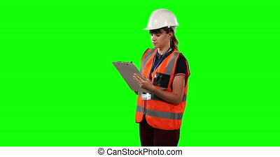 Front view of a site forewoman counting with green screen