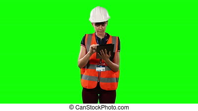 Front view of a site forewoman using digital tablet with ...